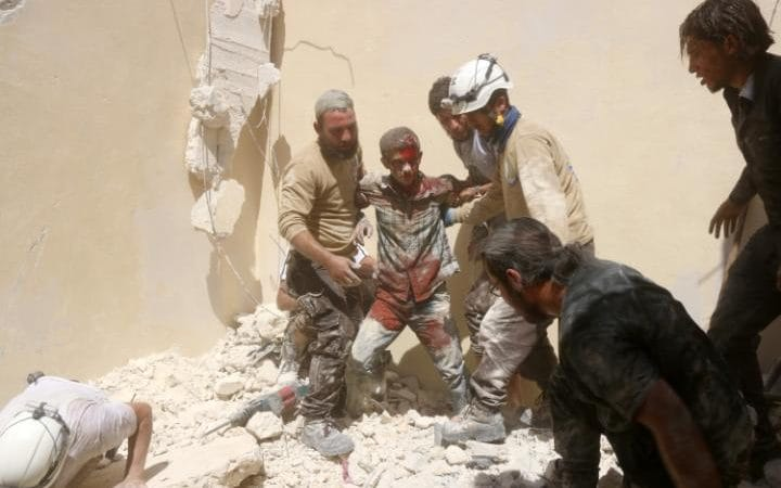 103495627_syrian_civil_defence_workers_rescue_a_wounded_young_man_from_under_the_rubble_of_a_col-large_transzgekzx3m936n5bqk4va8rwtt0gk_6efzt336f62ei5u